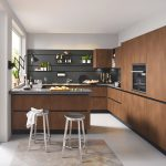 Contemporary Kitchen Idea Dominated By Black And Dark Wood Palettes Dark Wood Flat Paneled Kitchen Cabinets Black Countertop Open Shelving Idea Metal Stools