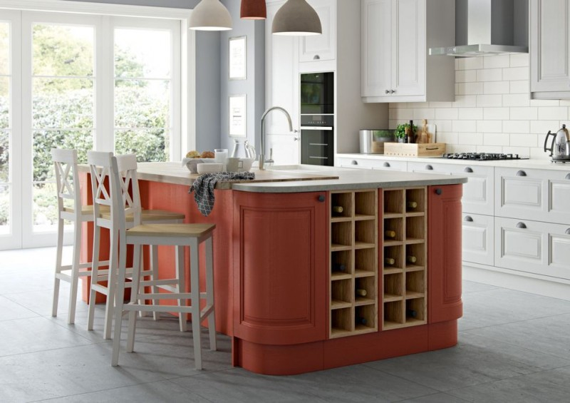 contemporary kitchen idea dusty pink kitchen island with white top and wine shelves white bar stools white kitchen cabinets stainless steel appliances