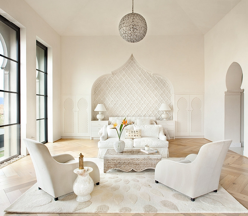 elegant white living room in Moroccan style white sofa and armchairs white Moroccan coffee table curved wall background white carpet with motifs light wood floors
