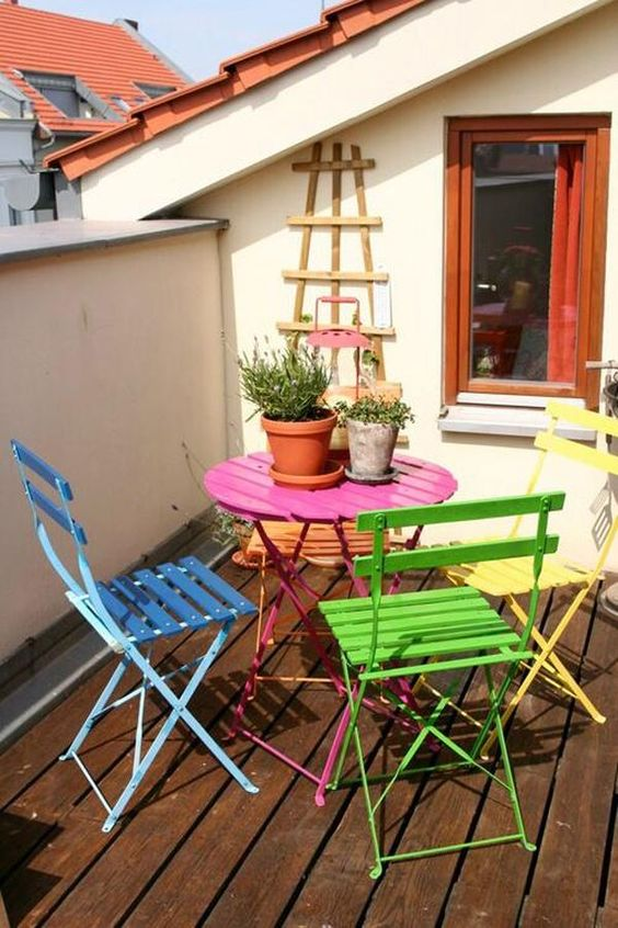 fun rooftop idea rainbow colored dining furniture set dark wood wood plank floors