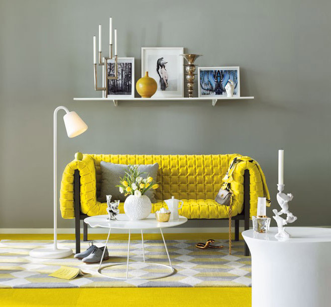 gray wall white single shelf textural yellow sofa round top coffee table in white modern carpet dominated in gray white yellow floors modern white floor lamp