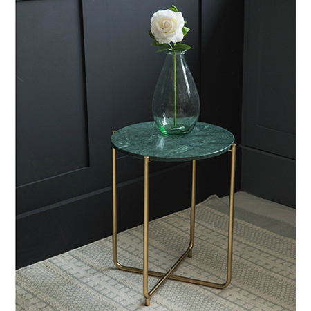 green marble side table with round surface and brass legs glass vase living flower