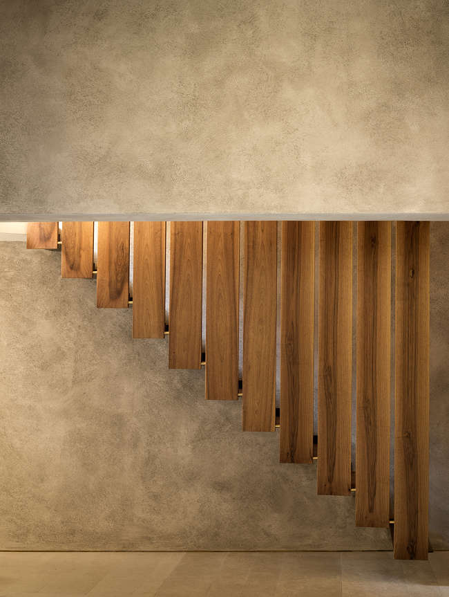interior stairs in different angle wood plank railings concrete walls
