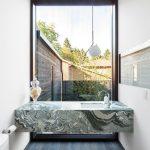 Modern Bathroom Idea Green Marble Bathroom Vanity White Undermount Sink White Toilet Dark Wood Plank Floors White Walls Giant Glass Window With Black Frame
