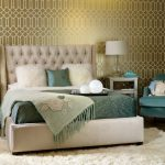 Modern Bedroom Idea Gold Toned Wall With Patterns Bed Frame With Tufted Headboard Blue Bedding Treatment White Shag Rug Two Bedside Tables With Drawer System Table Lamps