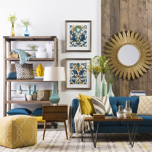 modern bohemian living room idea decorative wall mirror with brass finishing wood display mid century modern wood side table yellow pouch blue mid century modern sofa and coffee table rug with m