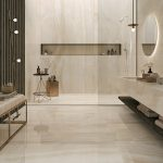 Modern Minimalist Bathroom Light Beige Marble Floors And Walls Recessed Shelf Round Mirror With Concealed Lighting Walk In Shower