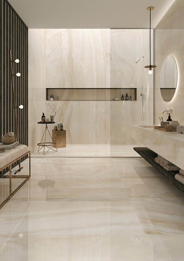 modern minimalist bathroom light beige marble floors and walls recessed shelf round mirror with concealed lighting walk in shower