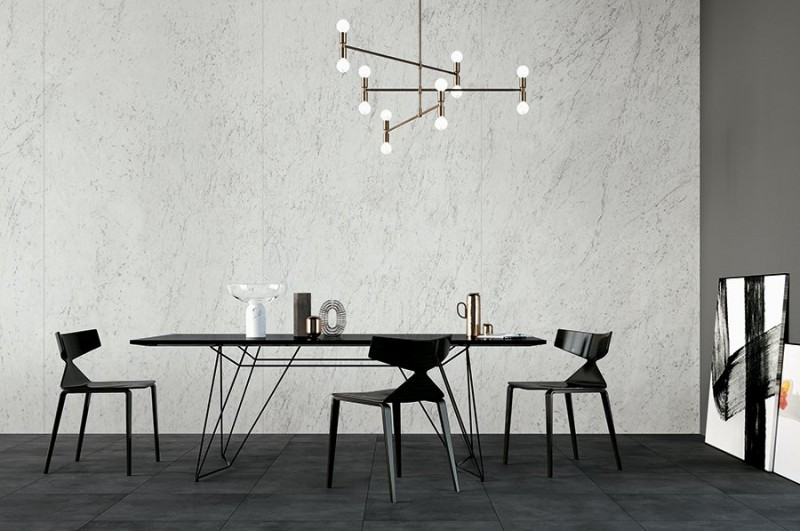 modern minimalist dining space white marble wall black tiled floors black dining furniture set in modern style modern chandelier with brass finish