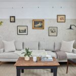Scandinav Rustic Living Room Halfway White Concrete Wall Halfway Gray Concrete Wall White Sofa Wood Chair With Black Leather Seat Feature Wood Top Coffee Table With Dark Legs