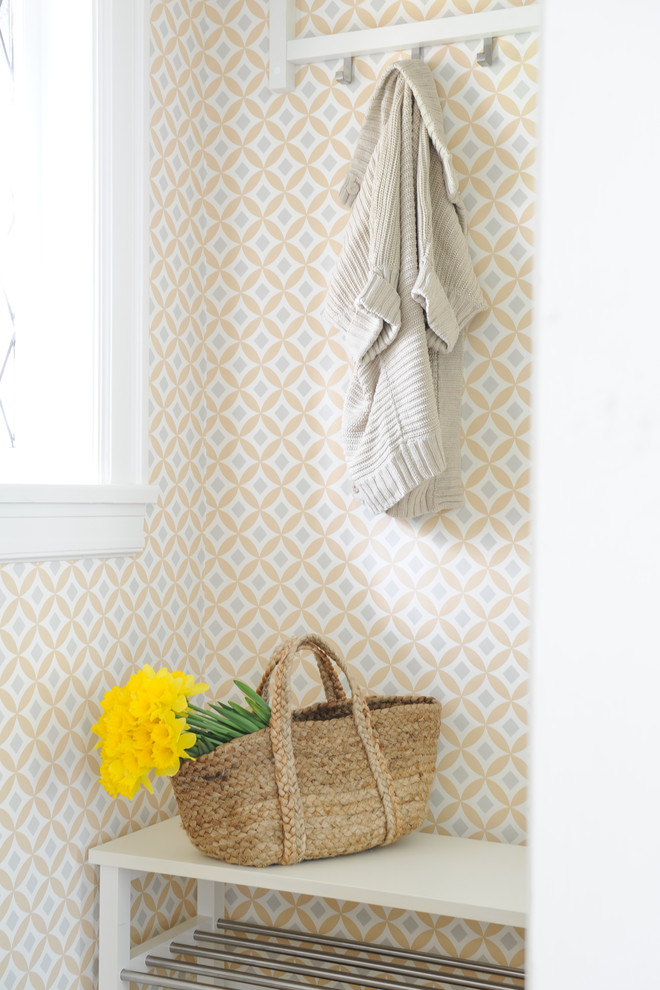 scandinavian entryway yellow wallpaper with diamond cut patterns white wood bench with under shelf few hooks