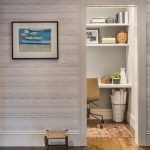 Simple Light And Neutral Wallpaper With Horizontal Patterns Black Framed Wall Decor White Door's Frame Medium Toned Wood Floors