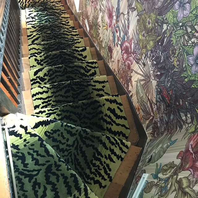 stair Tigress runner in green almond floral wallpaper