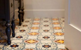 Mexican tiled flooring idea with golden yellow and deep red tones