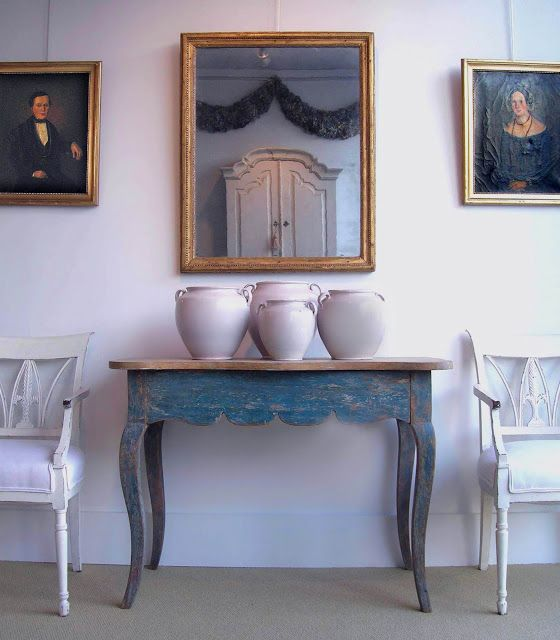 Swedish antique hall console table Antique French pots in white a pair of chairs some wall decors