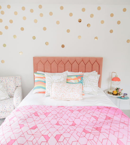 bedroom design white walls with gold toned polka dots bed frame with boldly peach headboard multicolored polka dot armchair pink comforter