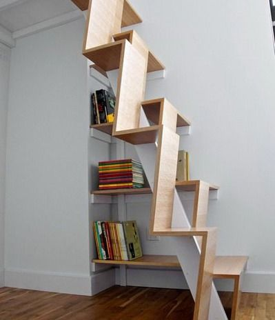 contemporary wood stairs with book shelves