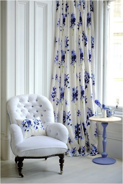 elegant curtain with purple flower patterns white armchair with throw pillow purple stand side table with round top