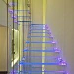 Floating Glass Stairs With Purple Light
