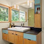 Floating Light Wood Bathroom Vanity With Black Countertop Undermount Sink In White Wood Cabinets And Blue Painted Drawers Extra Wood Framed Mirror