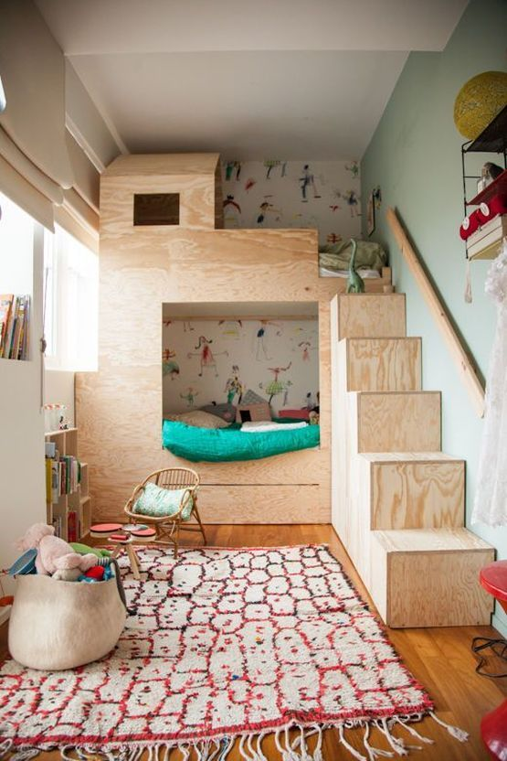 kids' room thick wood stairs multicolored area rug
