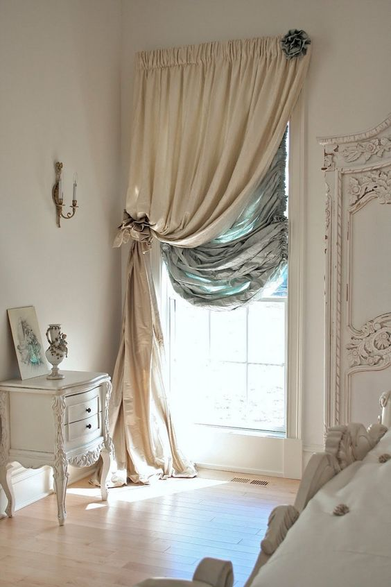 linen curtains in light neutral color antique hall table in white