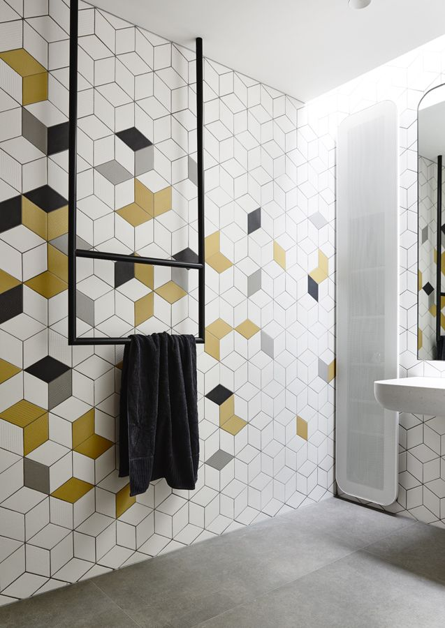 modern bathroom tiled walls with sunny yellow and deep black accents ceiling mounted towel holder concrete flooring idea