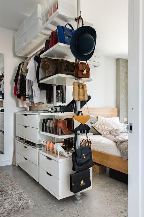open space bedroom idea open closet in white gray ceramic tile floors