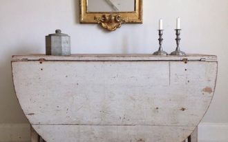 pale toned drop leaf table for entryway brass framed wall mirror metal candle stands