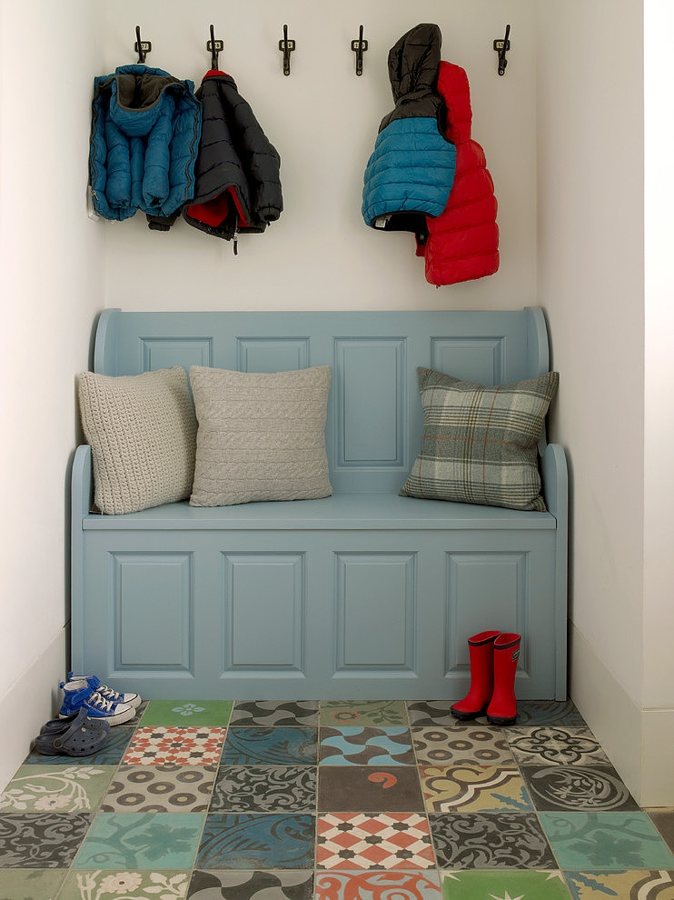 patterned and colorful entryway flooring idea blue painted bench seat with back rest gray pillowcased throw pillows wall mounted jacket holders