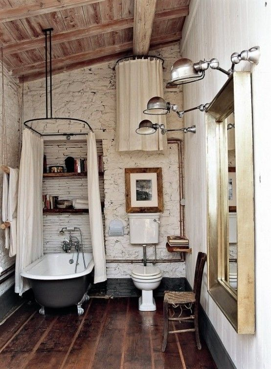 rustic colored small bathroom idea hard textured wall in white traditional bathtub with clawfoot white shower curtains with black metal rods white toilet dark wood floors wood ceilings with expos