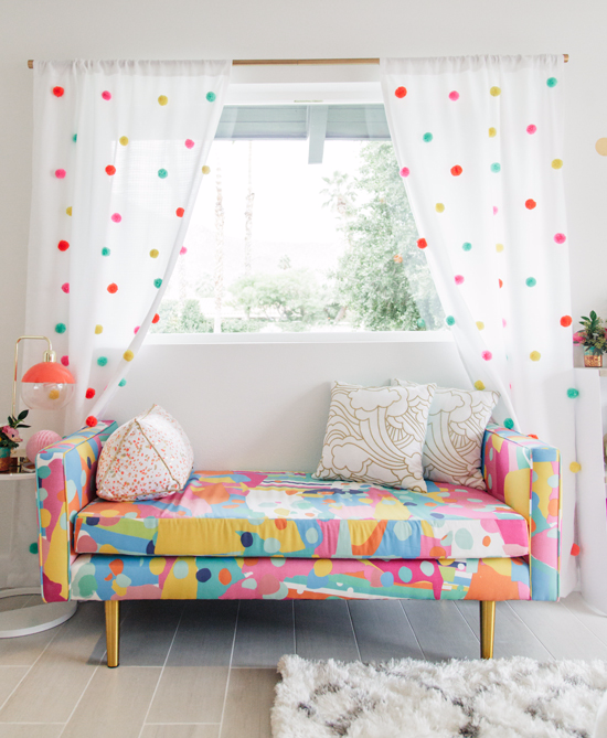 seating nook idea fun colored seat with brass legs fluffy white rug white curtains with fun colored polka dots light gray planks flooring idea