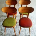 Series Of Mid Century Modern Chairs With Wood Angled Legs And Colorful Foam Seater