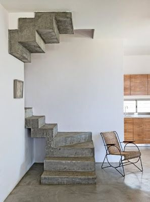simple concrete stairs with a reflective stairs on top