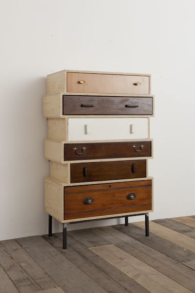 timber drawer system with dissimilar sides and dark finished metal legs