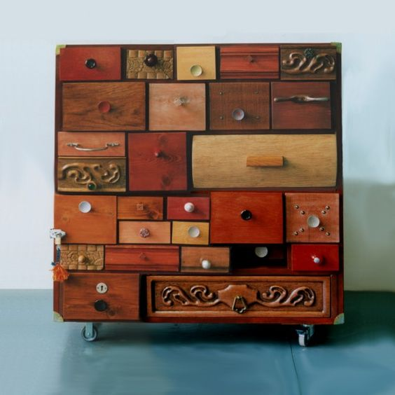 vintage storage solutions with handmade carvings on fronts