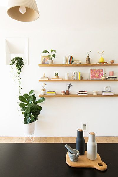 Scandinavian style bookshelves little greenery