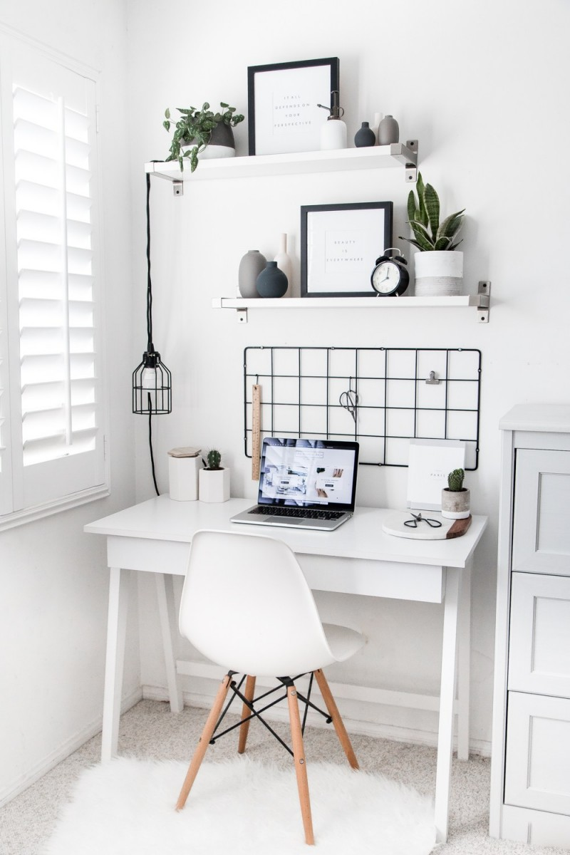 Scandinavian style home office idea white open shelves modern black pendant mid century modern working chair in white white working desk