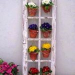 Abandoned Old Window Frame With Hanging Flowers