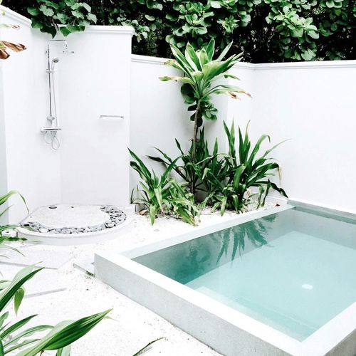 all white in ground hot tub outdoor shower space idea green plants for outdoor