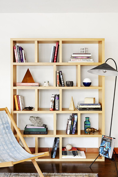 asymmetrical angled bookcase made of light wood