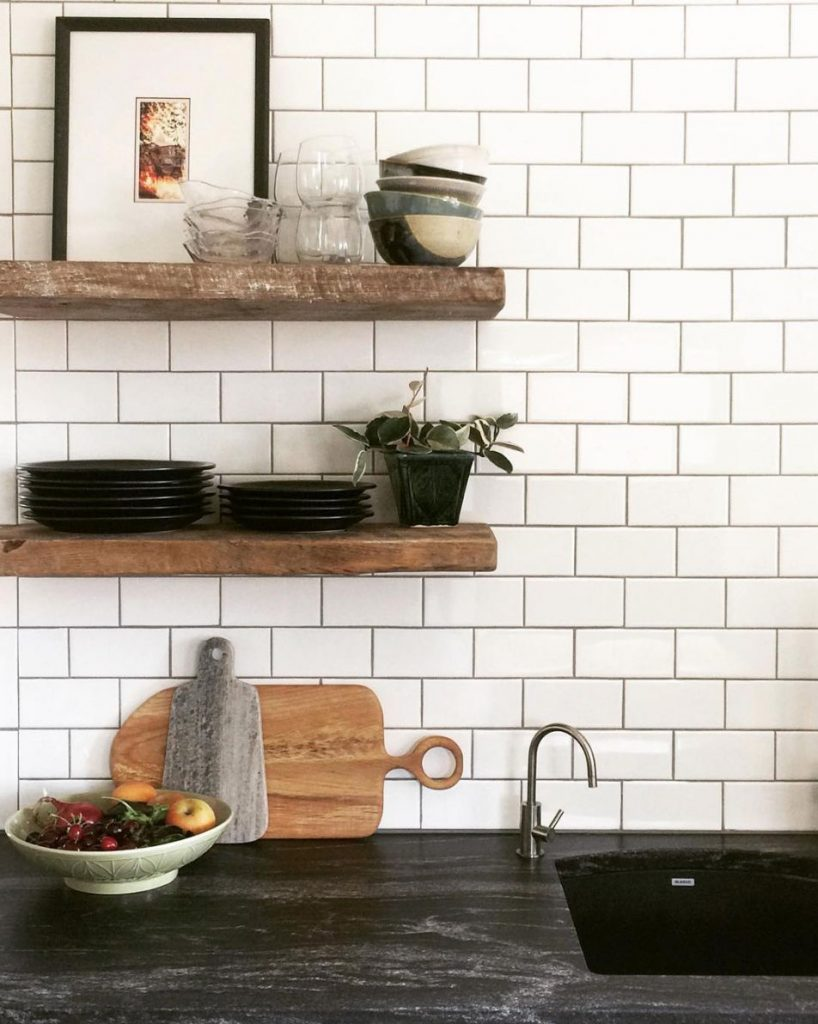 black granite kitchen countertop idea white subway tiles backsplash wooden open shelves
