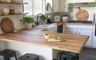 butcherblock kitchen countertop idea farmhouse kitchen sink black plastic stools wooden open shelves white kitchen cabinets