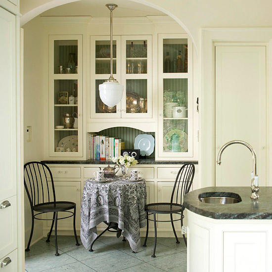 classic small breakfast nook idea black wrought iron chairs small dining table with linen placed over recessed buffet in white