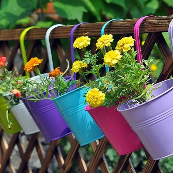 colorful planters hooked on the fences