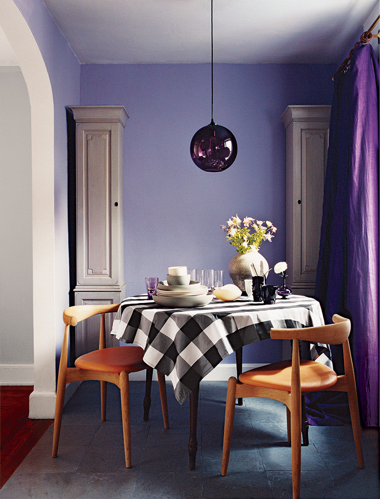 deep purple wall color accented by decorative pillars picnic themed dining furniture plum pendant