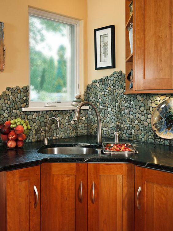 deeper corner sink stainless steel faucets stoned backsplash black counter wood cabinets