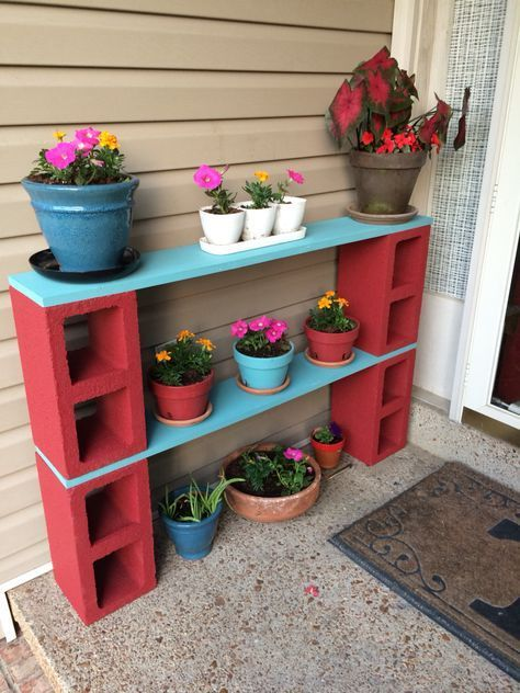 handmade plant pot rack in red and blue some plant pots