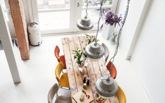 industrial eat in kitchen design rustic dining table colorful modern dining chairs brightly white interior space