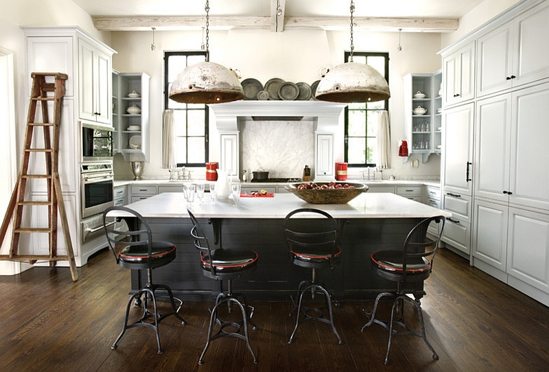 industrial eat in kitchen salvaged pendants metal stools dark island with white worktop dark wood floors